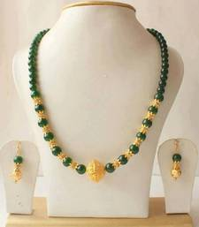 Buy Gorgeous emerald gold tone necklace set necklace-set online