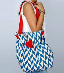 Buy Accrue with blue prints and heart shaped tassel.  handbag online