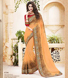 Buy Light Orange embroidered net saree with blouse net-saree online