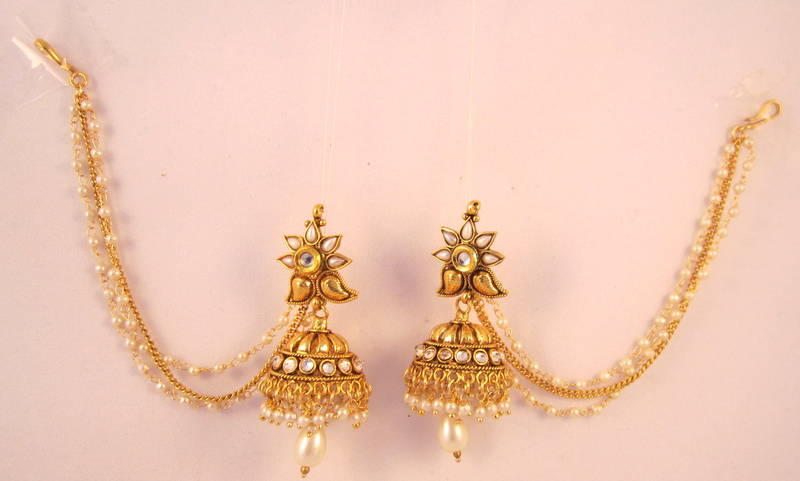 Jhumka earrings with chain beautify themselves with earrings