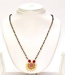 Buy Anvi's black beads with uncut stones and rubies mangalsutra online