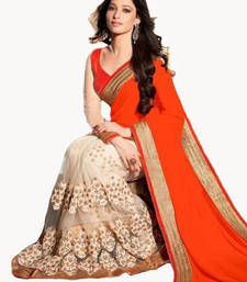 Buy Orange plain georgette saree with blouse tamanna-bhatia-saree online