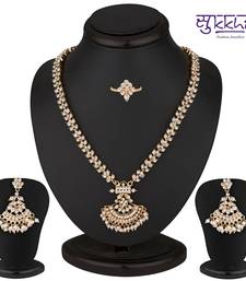 Buy Sukkhi Alluring Gold Plated AD Necklace-Earring-Ring Set necklace-set online