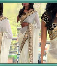 Buy WHITE GEORGETTE DESIGNER WEDDING WEAR EMBROIDERY LACE BORDER WITH BLOUSE SAREE..   wedding-saree online