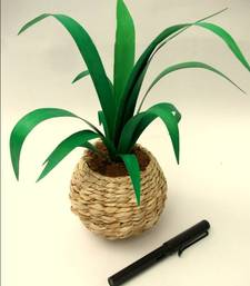 Buy Green leaves in a Banana fibre pot vase online