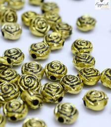 Buy Rose engraved golden beads  (500 + 100 pcs) stationery online
