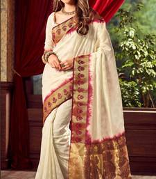 Buy Off white woven tussar silk saree with blouse tussar-silk-saree online