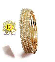 Buy Pearl and american diamond studded bangles bangles-and-bracelet online