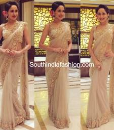 Buy Beige embroidered net saree with blouse other-actress-saree online