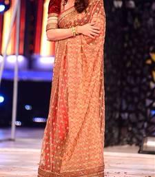 Buy Madhuri Dixit In Chiku net Saree madhuri-dixit-saree online