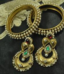 Buy Long Earrings with Maroon & Green colour stones & Gold Plated Bangles party-jewellery online