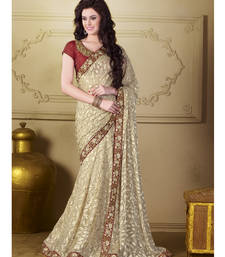 Buy Beige embroidered polyester saree with blouse party-wear-saree online