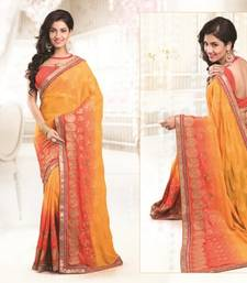 Buy Yellow and Orange embroidered viscose saree with blouse viscose-saree online