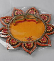 Buy Flower shaped pooja thali with two bowls for roli and chawal wedding-gift online