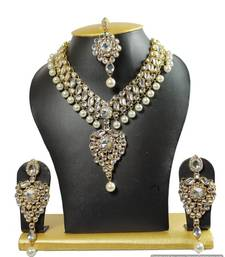Buy gold plated kundan necklace set with maang tika necklace-set online