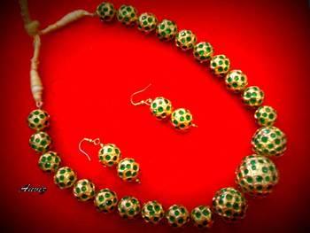 18 k gold earrings with green latkan