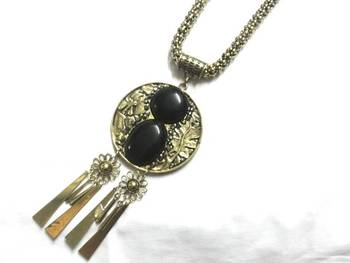 Black round pendant with long chain