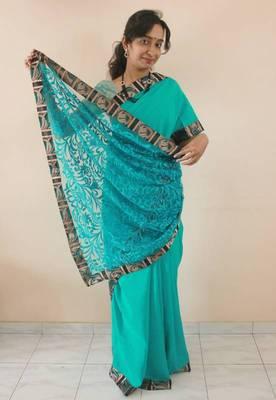 Sea green Crepe silk and net designer Saree