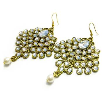 White kundan and pearl drop earrings