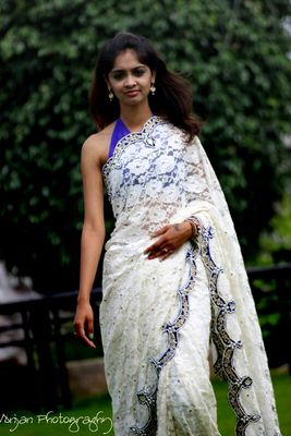 Embroidered white lace saree