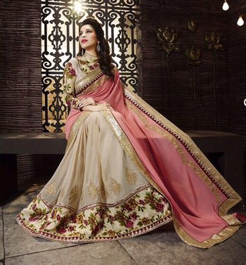 Light pink and beige embroidered georgette saree with blouse