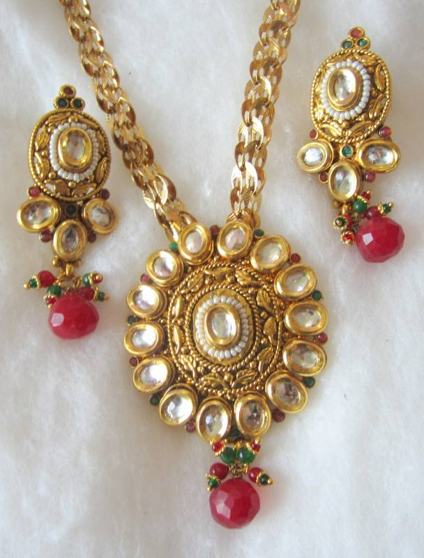 Buy gold plated chain kundan polki pendant earring set online gold plated chain kundan polki pendant earring set aloadofball Images