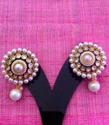 Buy Glowing  pearl polki warm glowing earring v654w stud online