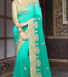 Buy georgette saree by Ravechi Fab (Turquoise) georgette-saree online