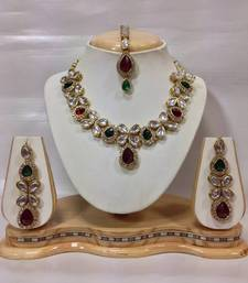 Buy Beautiful Kundan Jewelry Set in Maroon and Green ganpati-jewellery online