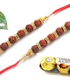Buy Maroon different stone beads and metallic casting rakhi with chocolates rakhi-with-chocolate online