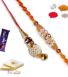 Buy Auspicious om and pearl lumba rakhi set of bhaiya bhabhi with gm kaju katli bhaiya-bhabhi-rakhi online