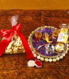 Buy Ganesha rakhi thali with cashew and ferrero rocher send-rakhi-to-indium online