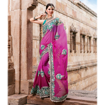 Magenta colored bemberg silk fabric saree with embroidery and dupion fabric blouse