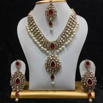 Dazzling kundan set in White and Red Stones and Pearls
