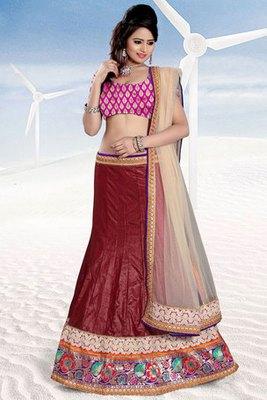 This a Maroon and Pink Art silk embroidered Lehenga Choli