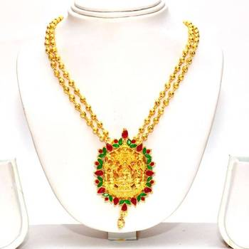 Anvi's lakshmi (temple jewellery) pendent and rubies pendent with gold toned gundla mala