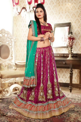 A Pink Net and Brasoo Lehenga Choli Decorated with Beautiful Diomand Work