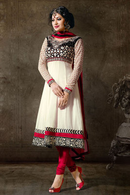 White Salwar Kameez Adorned By Embroidery And Lace Work