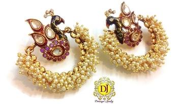 Blissful peacock earrings purple
