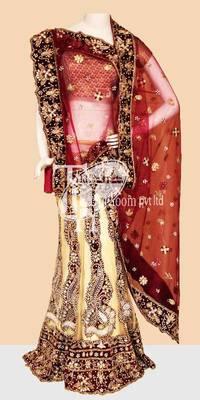 Sizzling cream with red heavy work beautiful design bridal lehenga