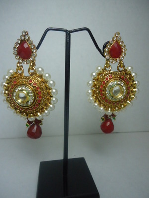 Classic Kundan Earrings studded with Pearls and stones.