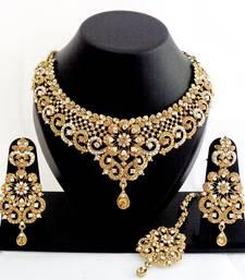 Buy Designer golden white stone wedding necklace set with maang tikka black-friday-deal-sale online