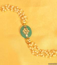 Buy Turquoise colour stone kundan  and  pearl bracelet Bracelet online