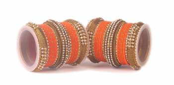 Orange Kundan bangles and bracelets