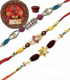 Buy Fancy designing beads rakhi of three with designer thali bhaiya-bhabhi-rakhi online