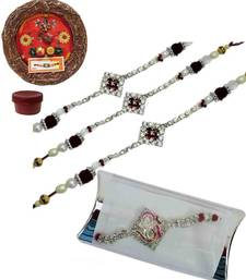 Buy Mesmerizing of four ad and bracelet rakhis with designer thali bracelet-rakhi online