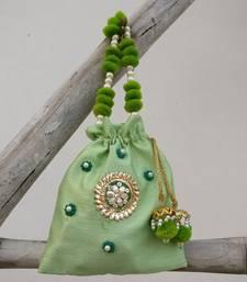Buy Green Raw Silk potli bag with Gota patti and Semi precious beads and pom poms potli-bag online
