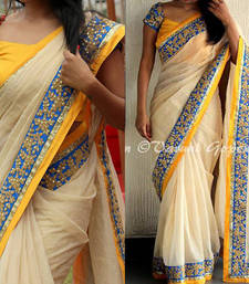 Buy Off white embroidered silk saree with blouse art-silk-saree online