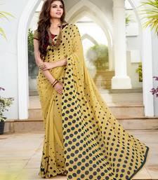 Buy beige printed georgette saree with blouse