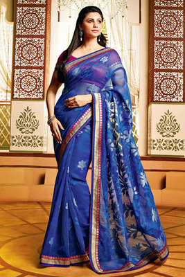 Daisy Shah Blue Colour Net Brasso Saree Comprising Floral Embroidery with Pink Blouse Piece